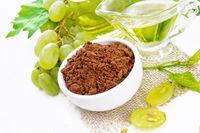 Flour grape seed in bowl on light board