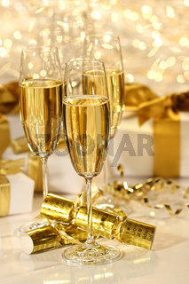 Glass of champagne against sparkle background