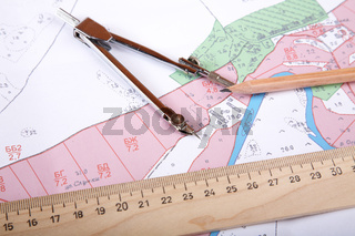 Topographic map of district with  measuring instrument and a pencil