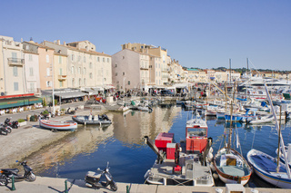 Saint Tropez, Old port view with fishing boats and colorful houses, Côte d'Azur. France, Europe