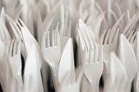 White plastic forks and knifes