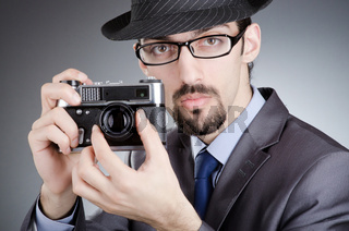 Photographer man with vintage camera