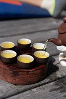 Tea ceremony, Woman pouring traditionally prepared tea