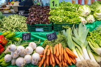 Radish, carrots and leek for sale at a market