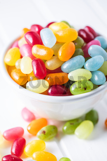 Sweet colorful jelly beans in bowl.