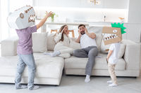 Happy family playing dinosaurs at home