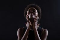 Young caucasian woman doing facebuilding yoga facial gymnastics self lymph facelift massage