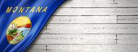 Montana flag on white wood wall banner, USA