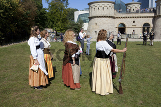 Women with muzzle-loading rifles during a live role-playing or R