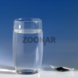 glass of water in blue back