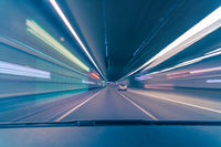 Highspeed drive in a tunnel, driving on the fast lane as concept for highspeed with colorful concept of the teal and orange movie look.