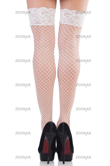 Woman legs with stockings on white