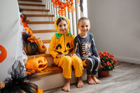 Cheerful siblings ready for halloween trick or treat