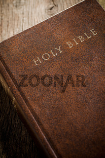 the Holy Bible on old wooden table