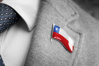 Metal badge with the flag of Chile on a suit lapel