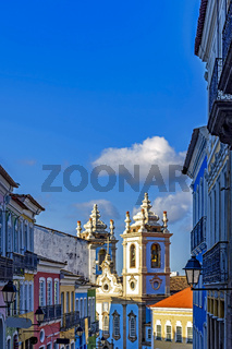 Old colorful houses facades and historic church towers in baroque and colonial style in Pelourinho district