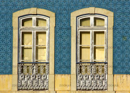 Old window on tile facade in Silves, Algarve - Portugal