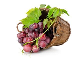 Dark blue grapes in a wooden basket