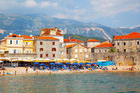 Beach in Budva with sunbathing people