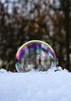 Freezing soap bubble with ice crystals on snow, Witten, North Rhine-Westphalia, Germany, Europe