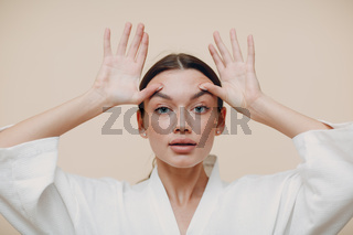 Young woman doing face building facial gymnastics self massage and rejuvenating exercise