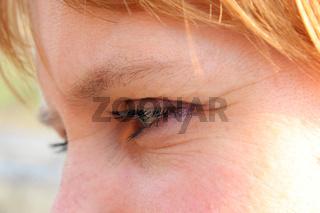 face of blue-eyed sympathetic girl