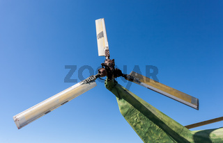 Propeller of old helicopter against blue sky