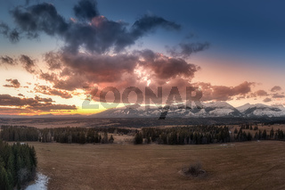 sunset with colorful clouds on the meadows below the Western Tatras