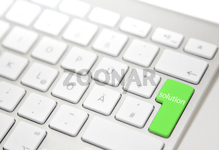 White computer keyboard with 'solution' button
