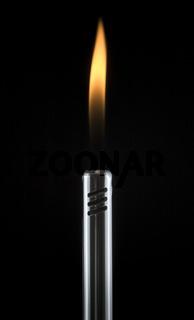 Detail of lit, gas barbecue lighter on black
