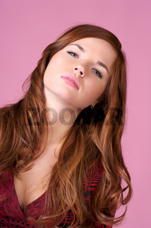 Portrait of beautiful red-haired female