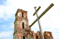 Old ruined red brick church. The consequences of the war.