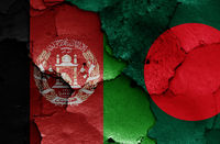flags of Afghanistan and Bangladesh painted on cracked wall