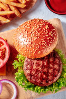 Beef patty with a burger bun, hamburger ingredients, a close-up