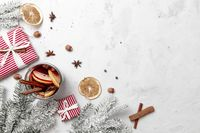 Christmas flat lay top view with glass cup of Mulled Wine, gift box, decorations