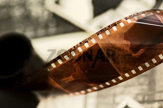 Grunge film strip over old unique photos