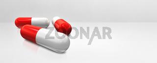 Capsule pill on a white concrete studio banner