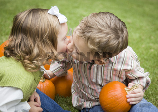 Cute Young Brother and Sister Kiss At the Pumpkin Patch