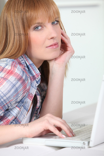 Ginger haired woman with laptop