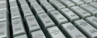 Lots of stacked silver bars