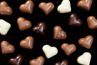 chocolate hearts on black