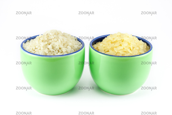 Two varieties of rice inside two cups of coffee