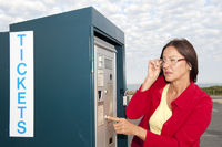 Woman at ticket machine