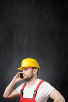 A construction worker using smartphone