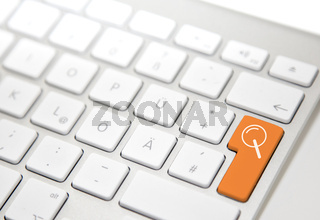 White computer keyboard with 'search' button