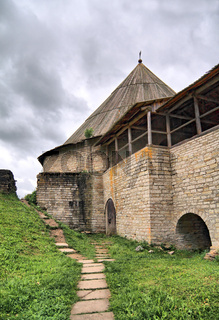 aging fortress on green hill