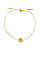 Golden bracelet with protection symbol isolated on a white background.
