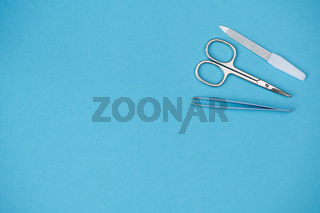 nail scissors, tweezers and nail file