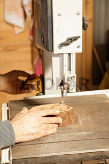 Artisan hands sawing billet