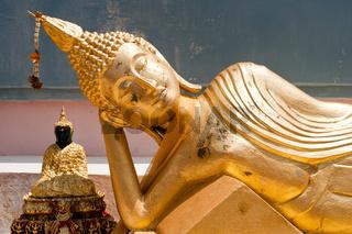 Golden statue of resting Buddha (Tuesday) in Wat Phra Yai Temple. Koh Samui island, Thailand